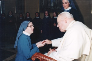 Touching the hand of a saint!